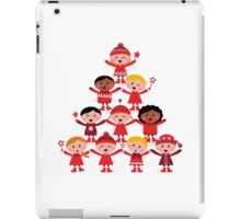 Happy multicultural kids in red winter costumes. Great design for christmas party. iPad Case/Skin