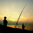 Fishing from the Beach at sunset. by Billlee