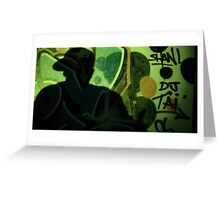 Hip hop rap rapper singer at night in dark nightclub bar graffiti wall with baseball cap Greeting Card