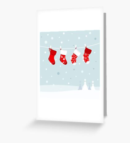 Cute christmas stockings, winter snow in background Greeting Card