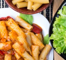 Top view of cooked rigatoni pasta with vegetable sauce Sticker