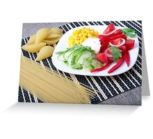 Pieces of fresh raw vegetables on a white plate Greeting Card