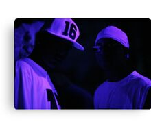 Hip hop rap gangster rappers singers at night in dark nightclub bar lit in pink black light wearing baseball caps Canvas Print