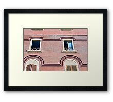 Facade detail with decorative windows and red brick  Framed Print