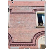 Facade detail with decorative windows and red brick  iPad Case/Skin