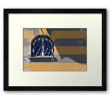 Arched window on a yellow gray striped wall Framed Print