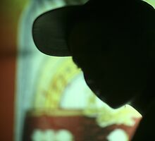 Rap hip hop singer  in bar nightclub in silhouette photograph by edwardolive
