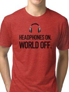 Headphones on, world off. Tri-blend T-Shirt