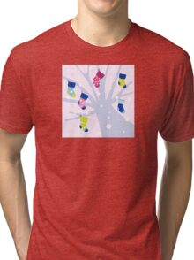 Winter colorful socks hanging from tree Tri-blend T-Shirt