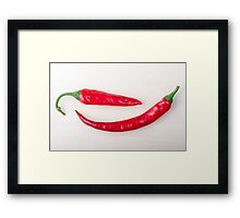Two red hot chili peppers closeup  Framed Print