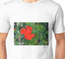 Red flower and green leaves, natural background Unisex T-Shirt