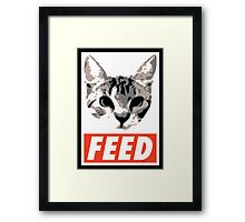 FEED the cat poster Framed Print