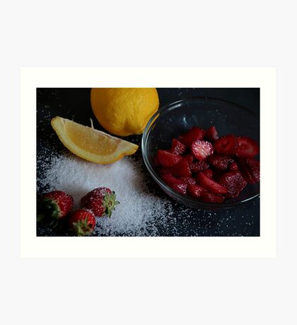 Bowl of straberries with lemon and sugar on black board. Art Print