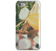 Picnic Basket With Orange Juice Bottle, Apples, Peaches, Oranges And Croissants On Green Grass In Spring iPhone Case/Skin