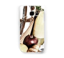 Picnic Basket With Orange Juice Bottle, Apples, Peaches, Oranges And Croissants On Green Grass In Spring Samsung Galaxy Case/Skin