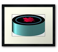 Hockey puck with red maple leaf Framed Print