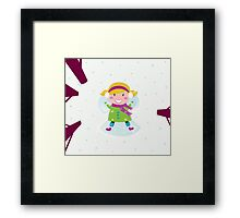 Happy christmas girl in winter nature making angel Framed Print