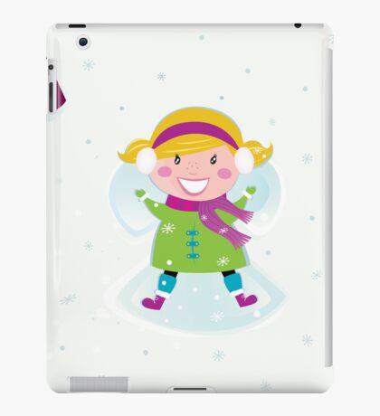 Happy christmas girl in winter nature making angel iPad Case/Skin
