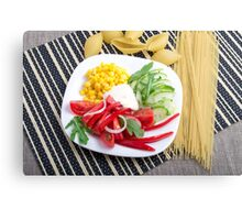 Top view of a white plate with slices of fresh vegetables Canvas Print