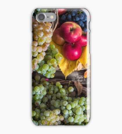 autumnal still life with fruit and leaves on a wooden base iPhone Case/Skin