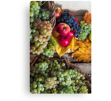 autumnal still life with fruit and leaves on a wooden base Canvas Print