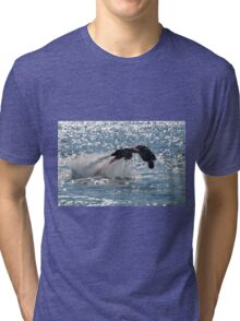 Flyboarder diving forwards headfirst into backlit sea Tri-blend T-Shirt