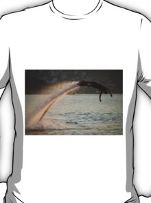 Flyboarder diving in perfect high backlit arc T-Shirt