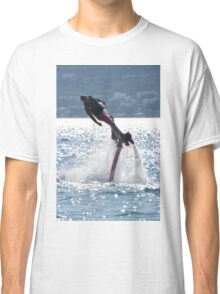 Flyboarder leaning into turn over backlit waves Classic T-Shirt