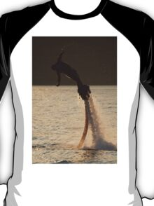 Flyboarder trailing water droplets leans into dive T-Shirt