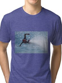 Flyboarder with outstretched arms low over water Tri-blend T-Shirt