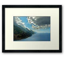 Dark clouds above the coastline Framed Print