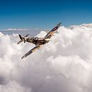 Spitfire above clouds by Gary Eason