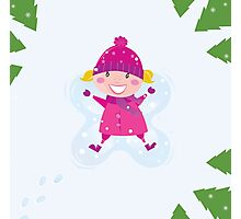 Happy blond girl making angel in snow Photographic Print
