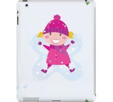 Happy blond girl making angel in snow iPad Case/Skin