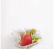 Strawberry Splashing In Milk by Dan Dexter