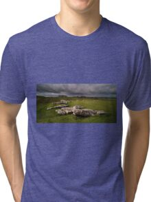 A storm brewing over Arbor Low     Tri-blend T-Shirt