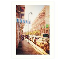 Blurred image of city street at sunset  Art Print