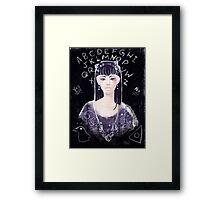 Ouija say? Framed Print