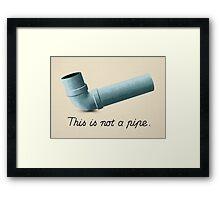Ceci n'est pas une pipe Framed Print