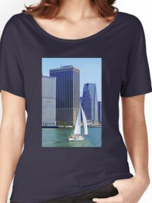 Sail Boat Sailing past the Skyscrapers Women's Relaxed Fit T-Shirt