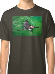 Penguin out for a swim in the green ocean Classic T-Shirt