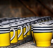 Mugs in a row by Pravine Chester