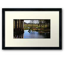 Pillars and river Framed Print