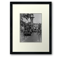 busy city clock tower Framed Print