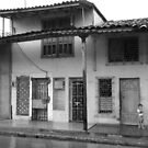 Kid in the rain by zumi