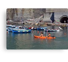 Boats on the coast of Vernazza (Vulnetia), a small town in province of La Spezia, Liguria, Italy. It's one of the lands of Cinque Terre, UNESCO World Heritage Sit Canvas Print
