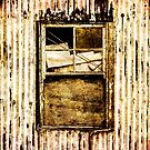 Window in a tin wall by Dave Hare