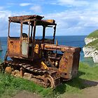 Rusty tractor at Flamborough North Landing by Anna Myerscough