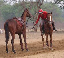 Jokey with two horses  by Ikramul Fasih