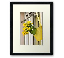 yellow flowers on the balcony Framed Print